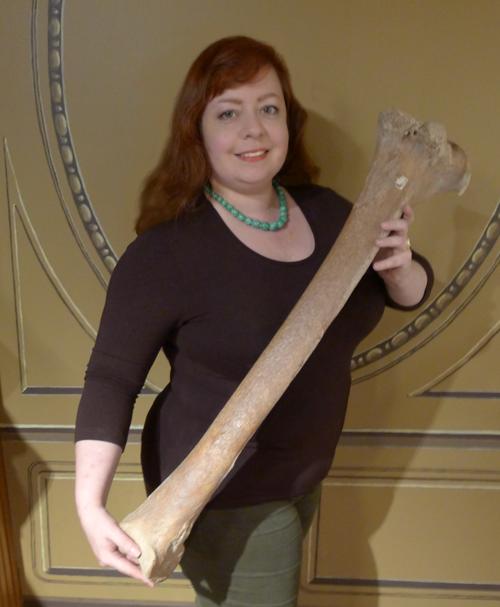 Emily Cotlier with a moa tibiotarsus leg bone.